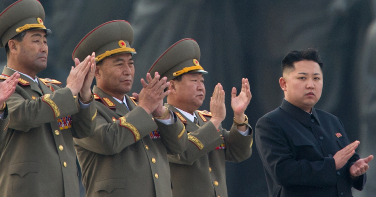 Kim Jong Un claps as he attends the unveiling ceremony of two statues of former leaders Kim Il Sung and Kim Jong Il in Pyongyang on April 13, 2012.</p>