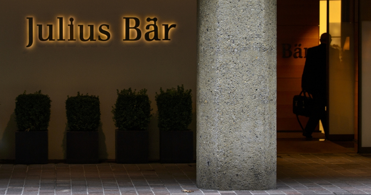 A man enters the Swiss private banking group Julius Baer headquarters on September 24, 2012 in Zurich.</p>