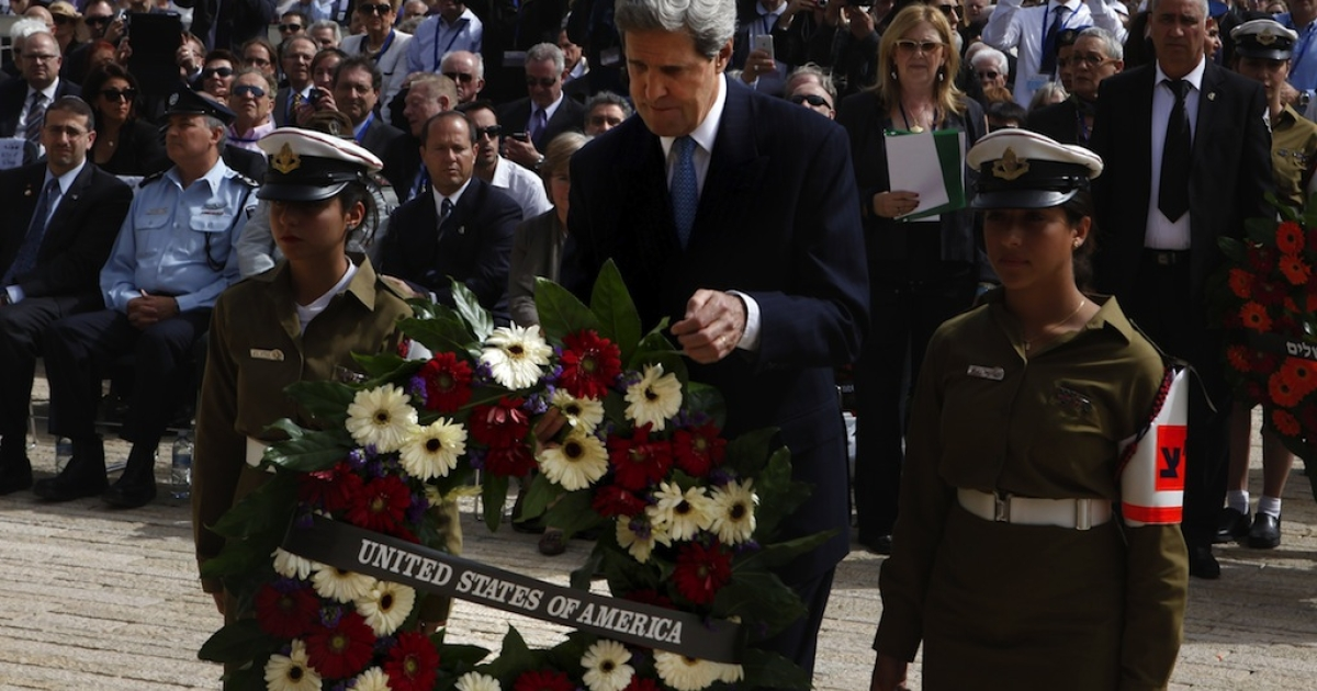 Secretary of State John Kerry lays a wreath during the annual ceremony for Holocaust Remembrance Day at the Yad Vashem memorial on April 8, 2013 in Jerusalem, Israel.</p>