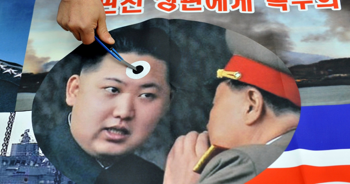 A South Korean activist stabs a pocket knife on a picture of North Korean leader Kim Jong-Un during an anti-North Korea rally near the national assembly in Seoul on March 22, 2013. Some South Korean web commentators want the US to blame North Korea for the Boston Marathon bombings.</p>