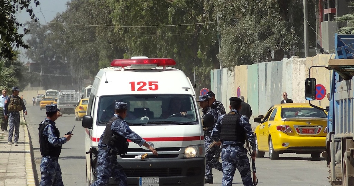Iraqi soldiers surround an ambulance as it arrives at a hospital following clashes between security forces and anti-government protesters, allegedly infiltrated by militants, on April 23, 2013 in Kirkuk.</p>