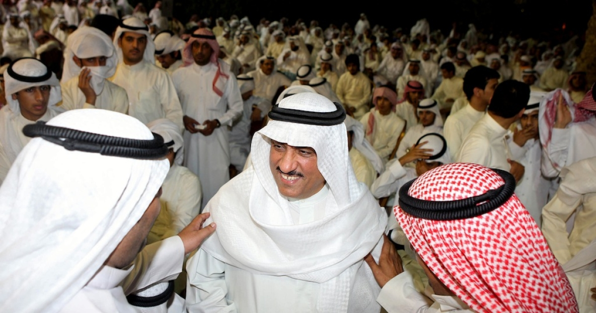 Kuwaiti opposition leader and former MP Mussallam al-Barrak (C) attends a demonstration in Kuwait City on April 17, 2013, against a court verdict to jail him for five years for insulting the Emir of Kuwait. Barrak, who says he is prepared to go to jail at any time, had refused to turn himself in three times because interior ministry officials failed to produce an original arrest warrant. He has now been granted bail.</p>