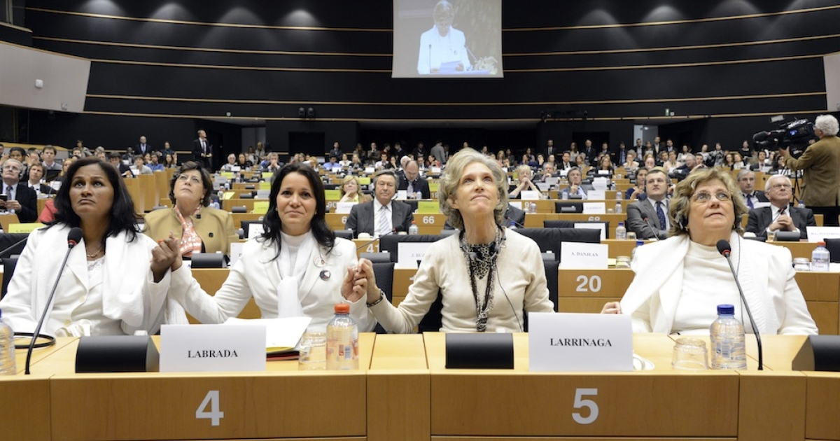 (L to R) Cuban Ladies in White (Damas de Blanco) Laura Maria Labrada Pollan, Belkis Cantillo Ramirez, Elena Larrinaga and Blanca Reyes Castanon hold hands at the European Parliament in Brussels on April 23, 2013. Over seven years after they were awarded the Sakharov Prize for Freedom of Thought by the European Parliament, they were able to receive their award.</p>