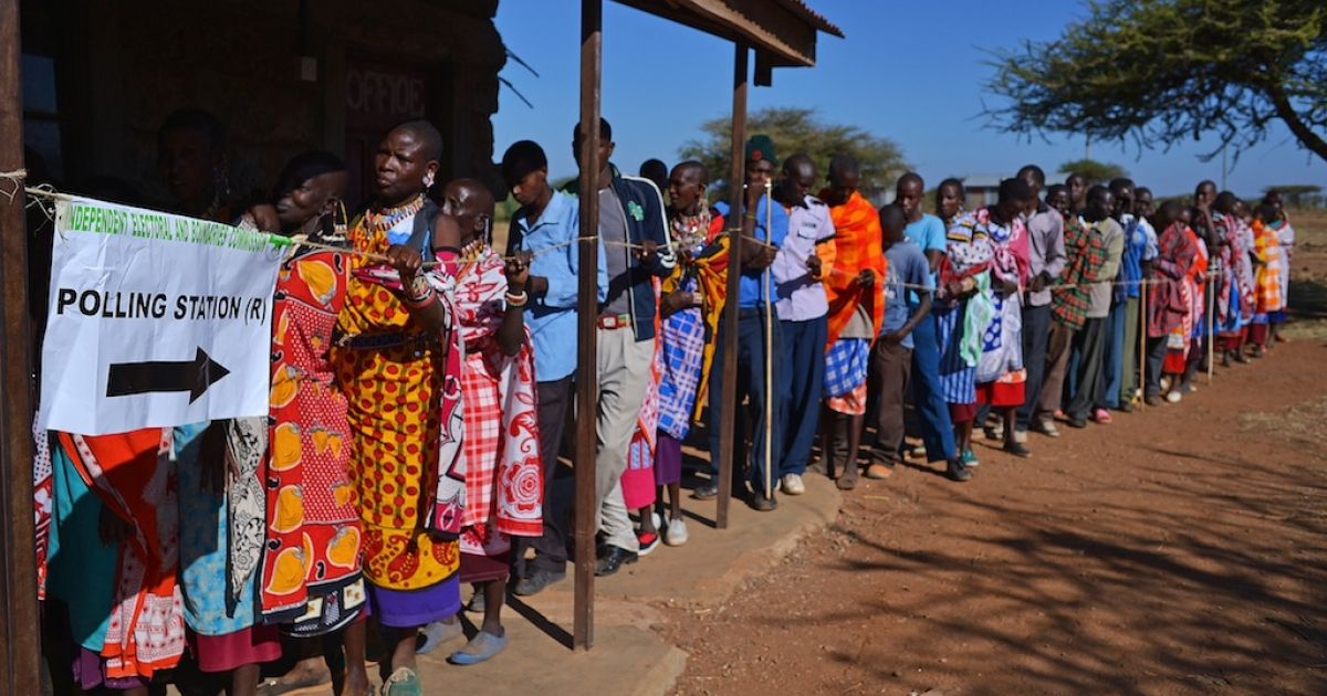 Maasai people queue to vote in Ilngarooj, Kajiado County, Maasailand, on March 4, 2013 during the nationwide elections.</p>