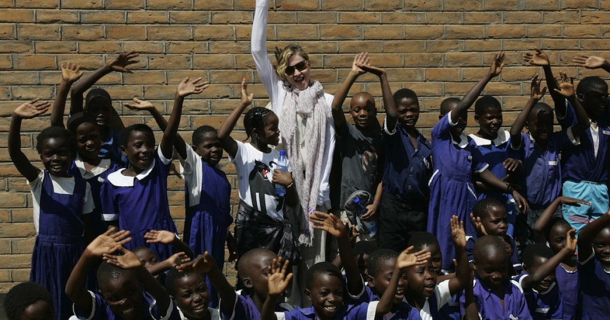 Madonna and her children David (to her left) and Mercy (to her right) visited Mkoko Primary School, one of the schools her Raising Malawi organization has built jointly with US organization BuildOn, on April 2, 2013.</p>