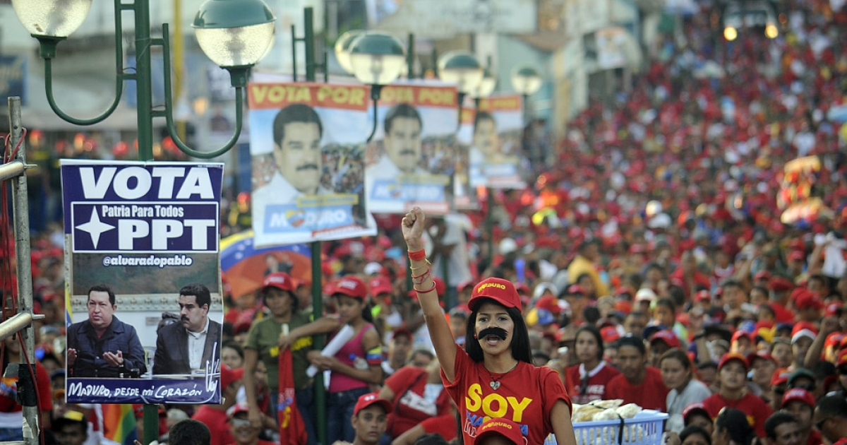 Supporters of Venezuelan acting President and presidential candidate Nicolas Maduro attend a campaign rally in San Juan de los Morros, Guarico state, Venezuela on April 7, 2013. Venezuelans will elect a new president April 14.</p>