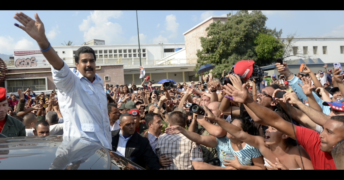 Nicolas Maduro waves to followers after casting his vote in Caracas on April 14. Venezuelans flocked to the polls Sunday to vote for Hugo Chavez's successor.</p>