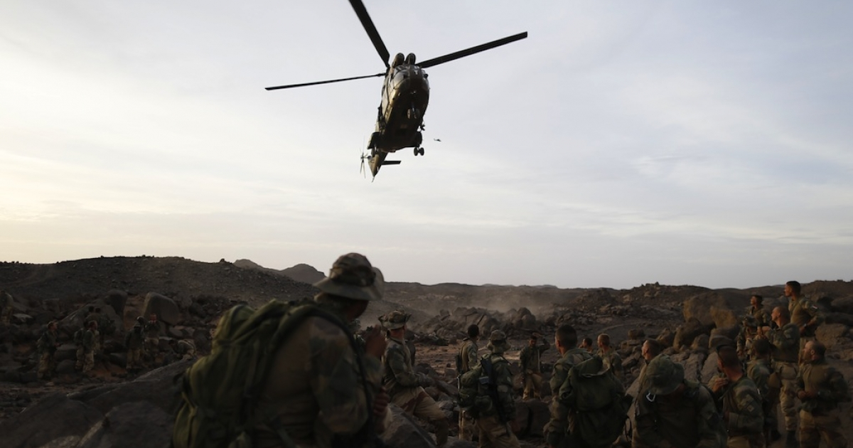 A Puma helicopter lands near the French army's 2nd Foreign Parachute Regiment in the Ifoghas mountains on March 17, 2013.</p>