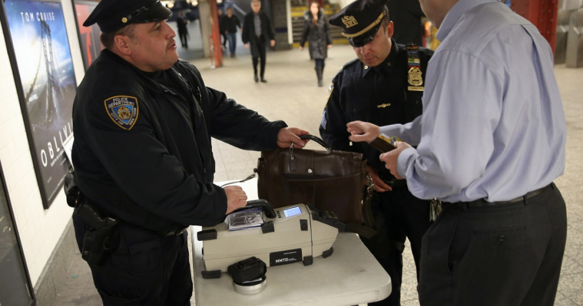Police check a subway passenger's bag at Penn Station on April 16, 2013 in New York City. Adis Medunjanin, a Bosnian-born US citizen, was sentenced to life in prison for helping to plan a suicide bomb attack on the New York subway system in 2009.</p>