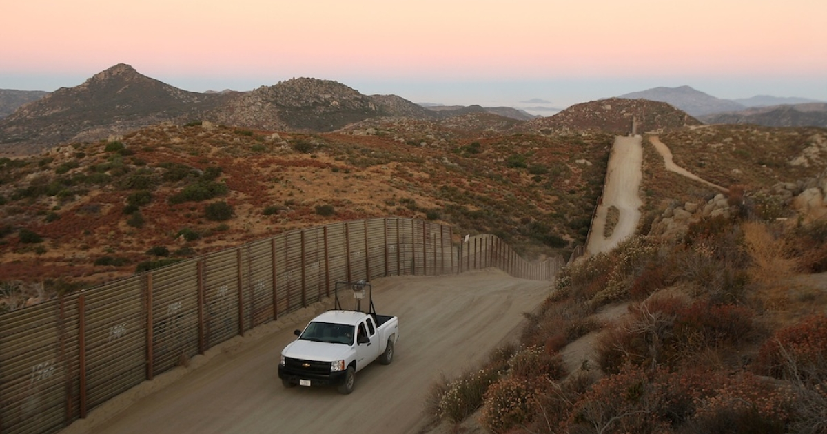 This photo taken on July 30, 2009, shows US Border Patrol agents driving near the US-Mexico border fence.</p>