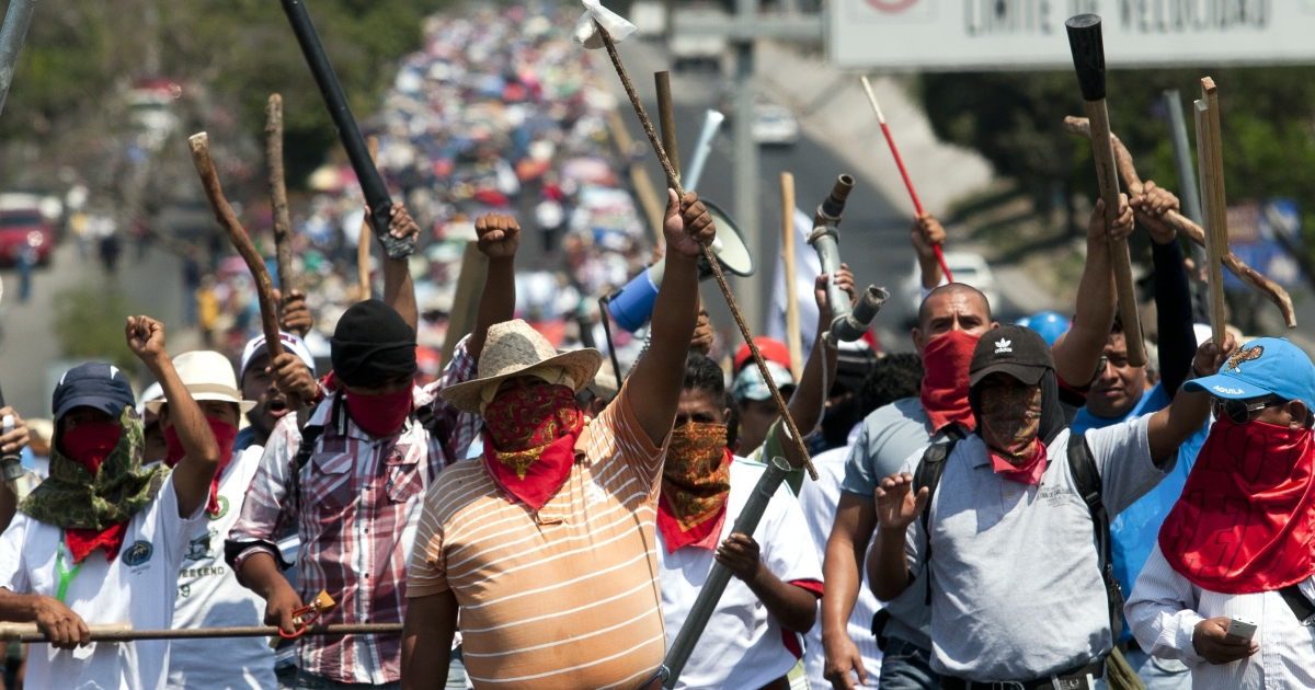 Teachers and citizen vigilantes march in southern Mexico's Guerrero state in protest of national education reforms.</p>