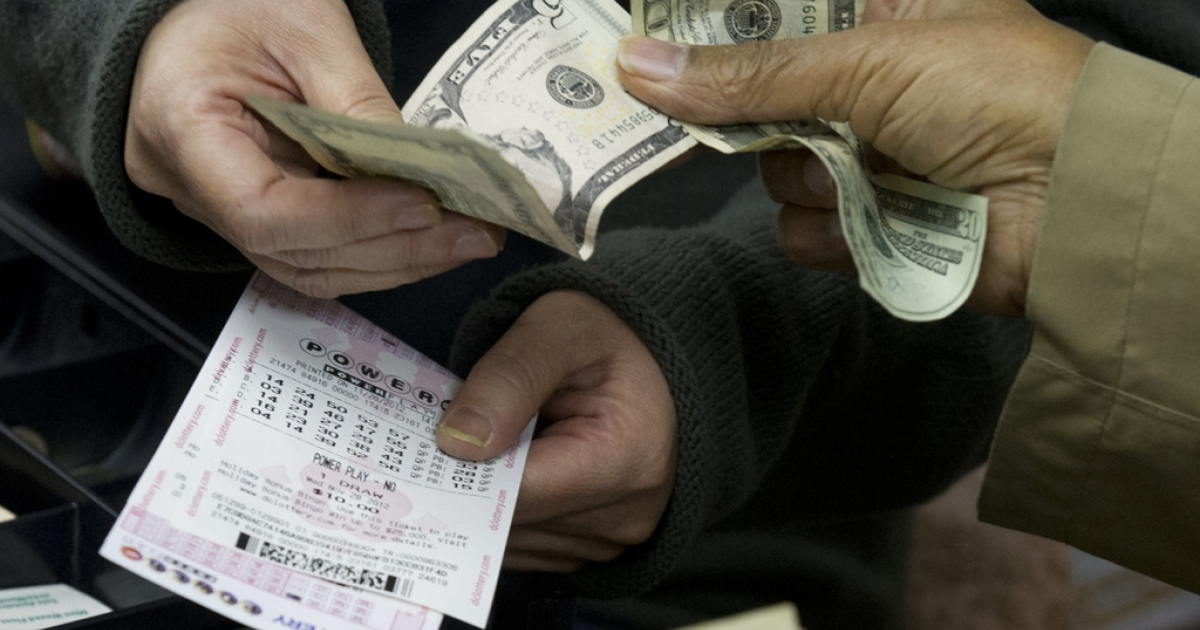 A customer purchases lottery tickets for the estimated record $425 million jackpot prize in Washington on November 26, 2012. Turns out, according to a University of Michigan study, that a lottery win would make you happier.</p>