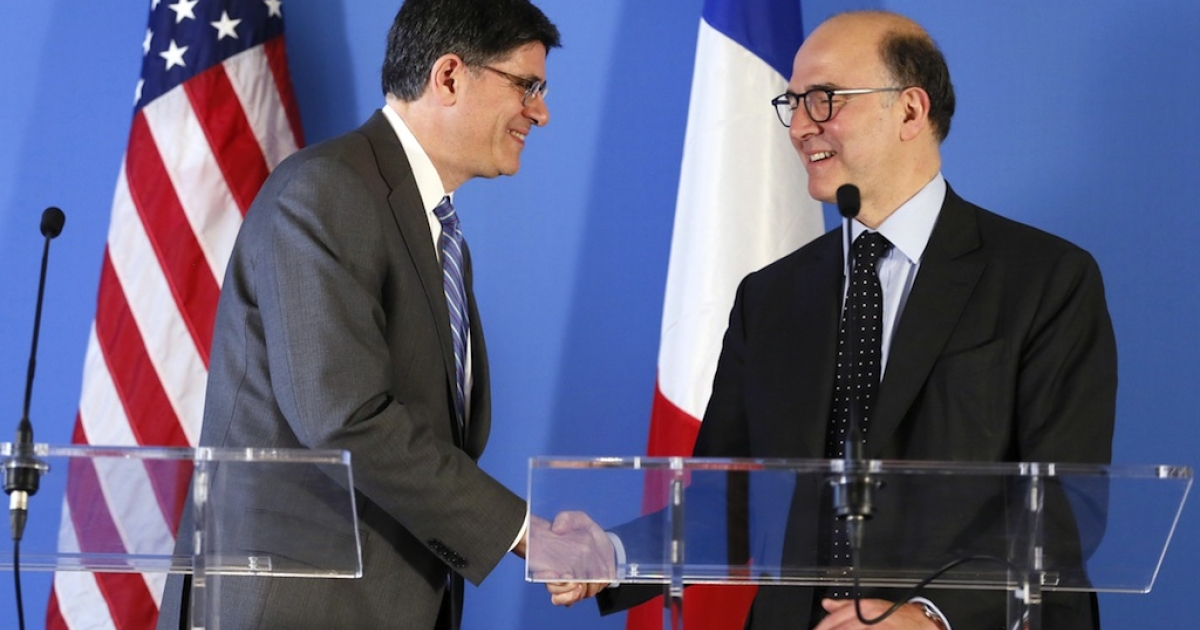 French Economy, Finance and Foreign Trade Minister Pierre Moscovici (R) shakes hands with US Secretary of Treasury Jacob Lew after giving a press conference on April 9, 2013, following a meeting at the US Embassy in Paris.</p>