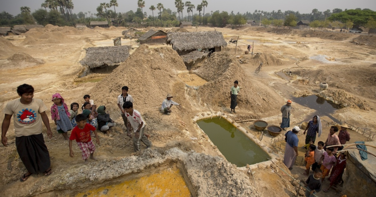 Children play next to pools of acid where displaced villagers produce copper from stolen mine material. The Monywa mine complex, Myanmar's largest, is a joint project between the nation's military and Norinco, a Chinese state-run weapons conglomerate.</p>