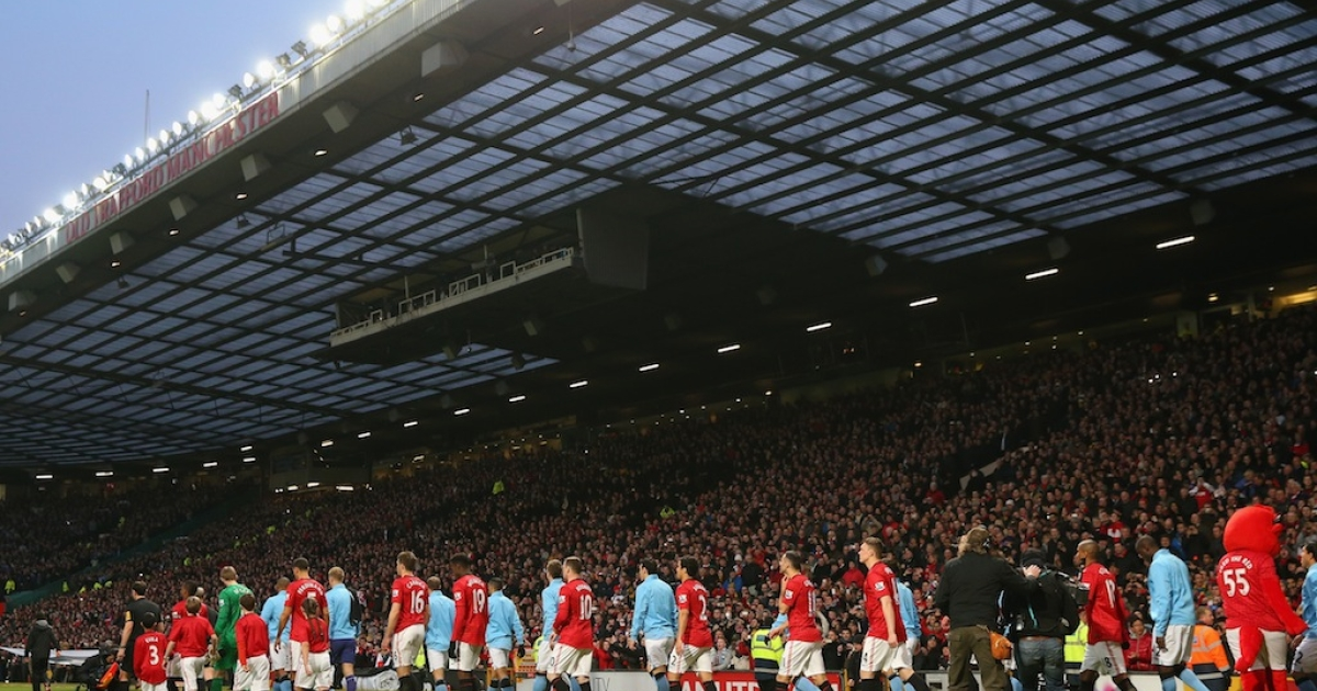 Manchester United and Manchester City players walk out prior the Barclays Premier League match between Manchester United and Manchester City at Old Trafford on April 8, 2013 in Manchester, England.</p>