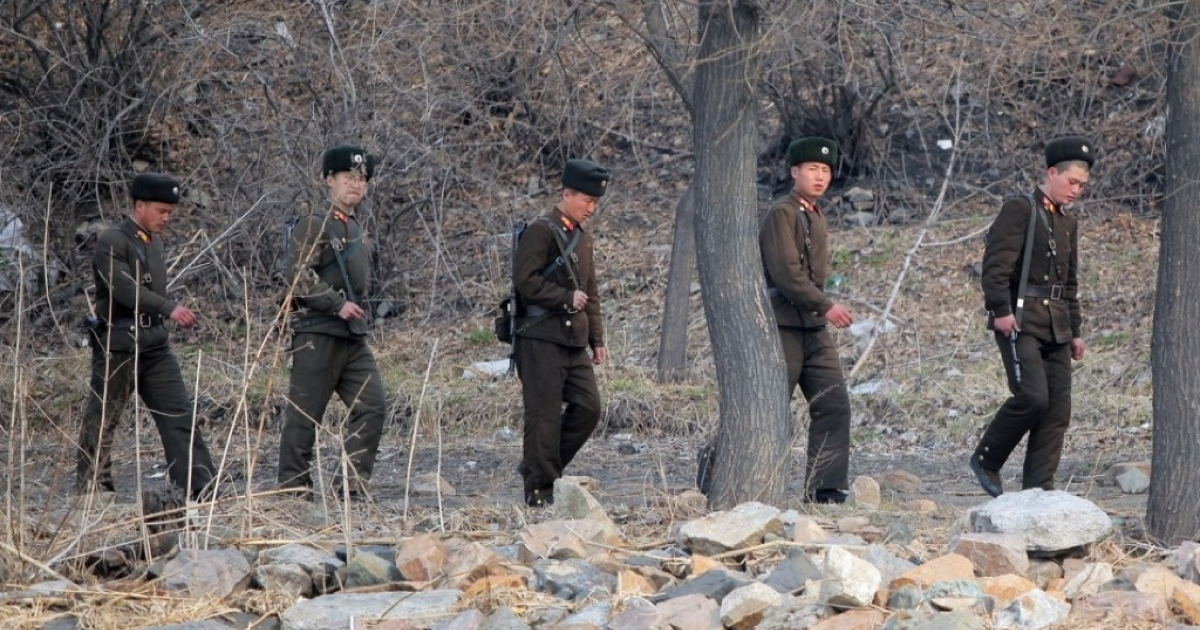 North Korean soldiers patrol along the bank of the Yalu River in the North Korean town of Sinuiju across from the Chinese city of Dandong on April 4, 2013.</p>