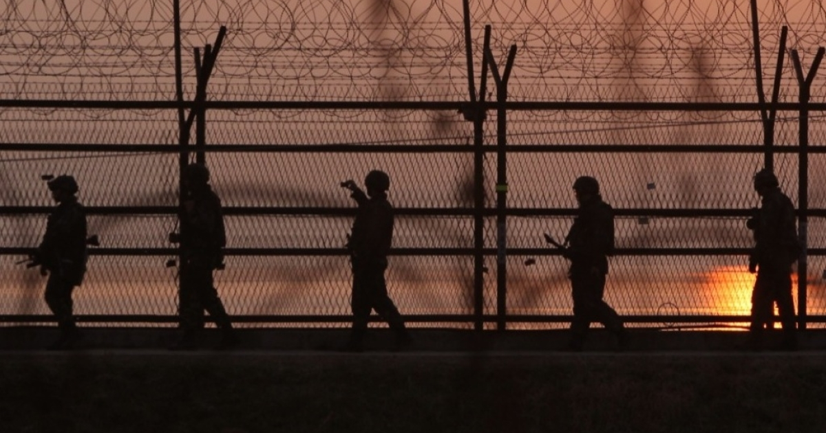 South Korean soldiers patrol inside the barbed-wire fence near the border village of Panmunjom on April 4, 2013 in Paju, South Korea.</p>