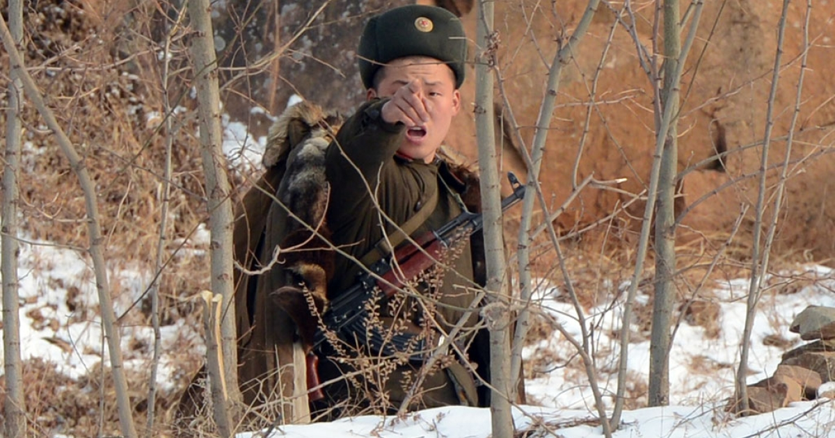 A North Korean soldier reacts as he patrols along the Yalu River near the North Korean town of Sinuiju after the country conducted it's third nuclear test on February 12, 2013.</p>