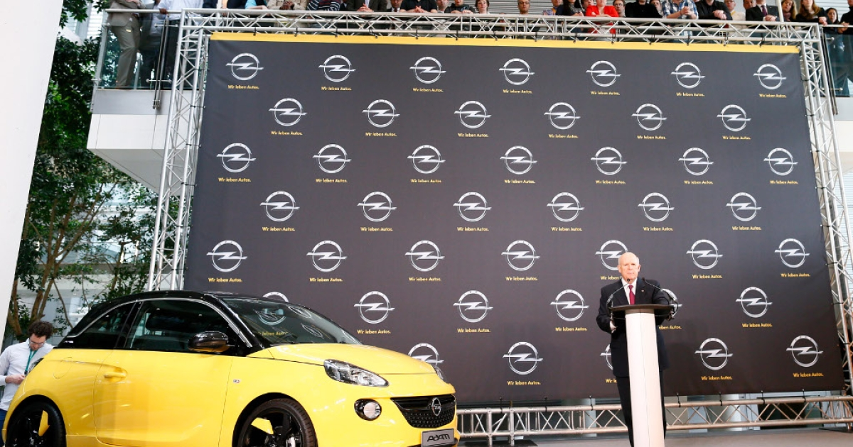 Dan Akerson, CEO of General Motors speaks next to an Opel car 'Adam' during a press conference at Opel headquarters on April 10, 2013 in Ruesselsheim, Germany.</p>