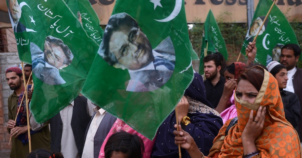 Supporters of former Pakistani military ruler Pervez Musharraf carry party flags during a pro-Musharraf rally in Quetta on April 19, 2013.</p>