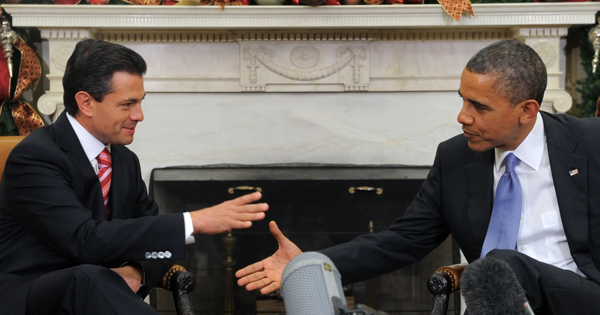 US President Barack Obama shakes hands with Mexico's then-president-elect, Enrique Peña Nieto, during a bilateral meeting in the Oval Office at the White House in Washington on Nov. 27, 2012.</p>