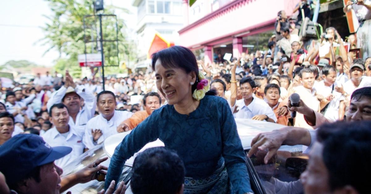 Aung San Suu Kyi arrives at the National League for Democracy headquarters on Nov. 14, 2010, in Yangon, Burma.</p>