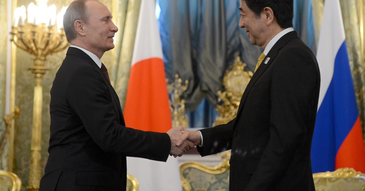 Russia's President Vladimir Putin shakes hands with Japan's Prime Minister Shinzo Abe during a meeting in Moscow on April 29, 2013.</p>