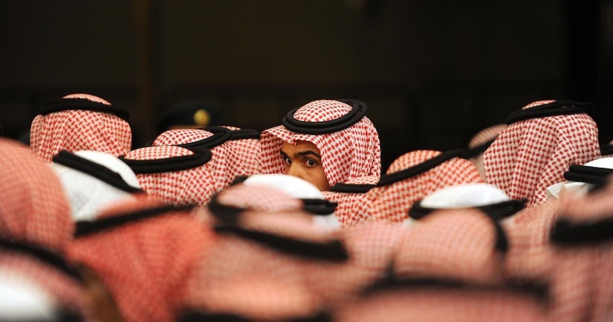 Saudi Arabian men wait outside the Masmak Palace to show allegiance to the kingdom's new Crown Prince Salman bin Abdulaziz in Riyadh on June 23, 2012.</p>