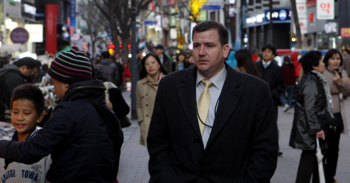 A foreign businessman walks in the Myungdong shopping district on April 11, 2013 in Seoul, South Korea. According to reports a North Korean missile launcher has been moved into firing position as the continuing threats of attack emit from Pyongyang. G8 leaders convened in London to discuss the situation.</p>