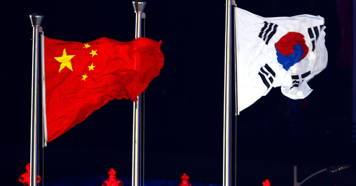 Chinese and South Korean flags displayed during the 16th Asian Games in Guangzhou, China, Nov. 27, 2010.</p>