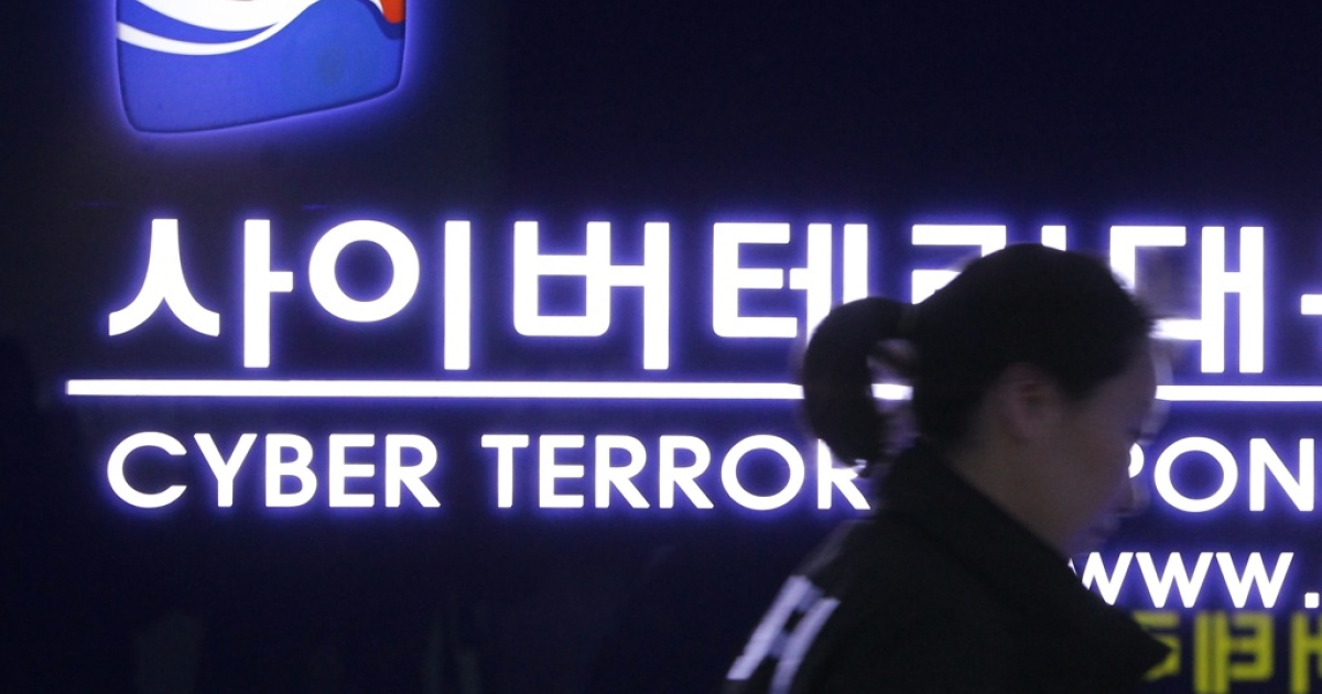 A South Korean police officer walks past the Cyber Terror Response Center in Seoul, South Korea, on March 21, 2013. South Korean investigators have traced a cyberattack on banks and broadcasters to North Korea's military intelligence agency.</p>