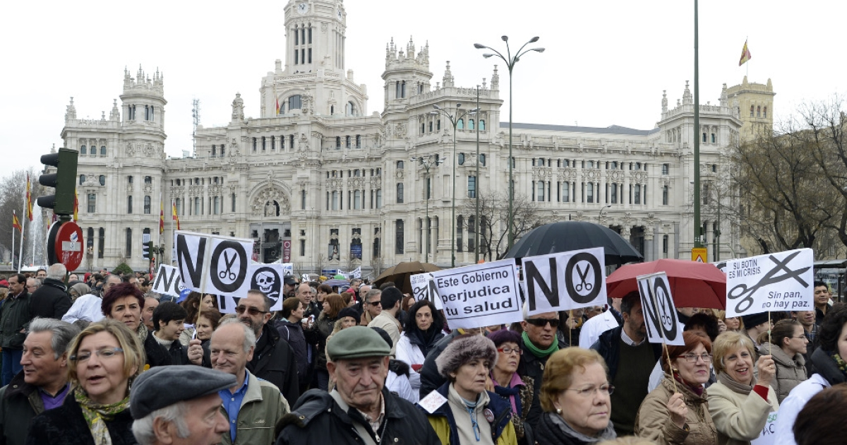 Demonstrators take part in a protest against government's austerity measures and health care spending cuts in Madrid on March 17, 2013.</p>