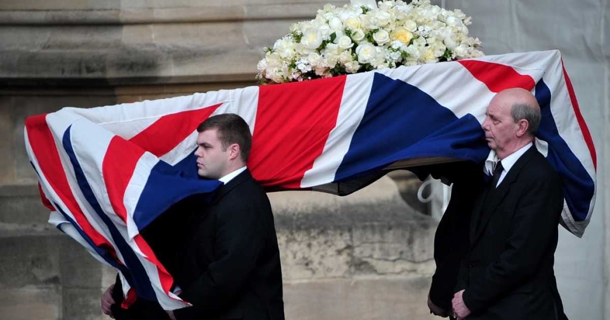 Pallbearers carry Thatcher's coffin.</p>
