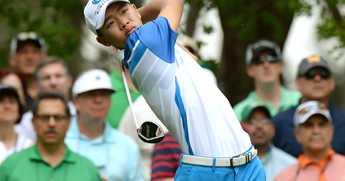 Tianlang Guan of China hits a shot during the first round of the 77th Masters at Augusta National on April 11, 2013 in Augusta, Georgia.</p>