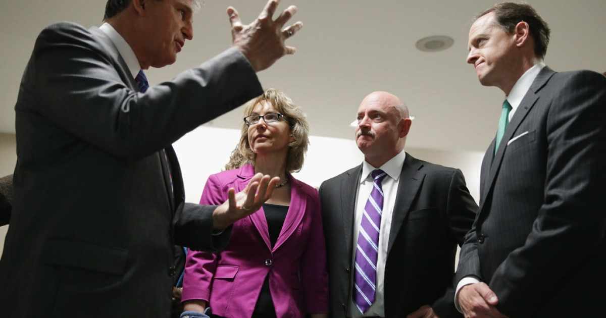 Shooting victim and former Rep. Gabrielle Giffords (2nd L) and her husband Mark Kelly (3rd L) join Sen. Joe Manchin (D-WV) (L) and Sen. Pat Toomey (R-PA) on Capitol Hill on April 16, 2013. Giffords and Kelly met with members of Congress over legislation to expand gun background checks.</p>