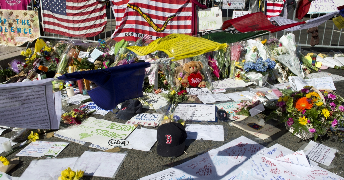 A makeshift memorial forms on the Boston Marathon route on April 18, 2013 in Boston, Massachusetts.</p>