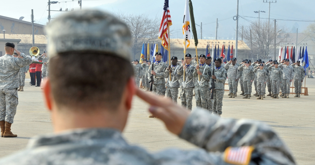 Soldiers of the US Army's 23rd Chemical Battalion salute at the national flag during a ceremony to recognize their official return to the 2nd Infantry Division located in South Korea, at Camp Stanley in Uijeongbu, north of Seoul, on April 4, 2013.</p>