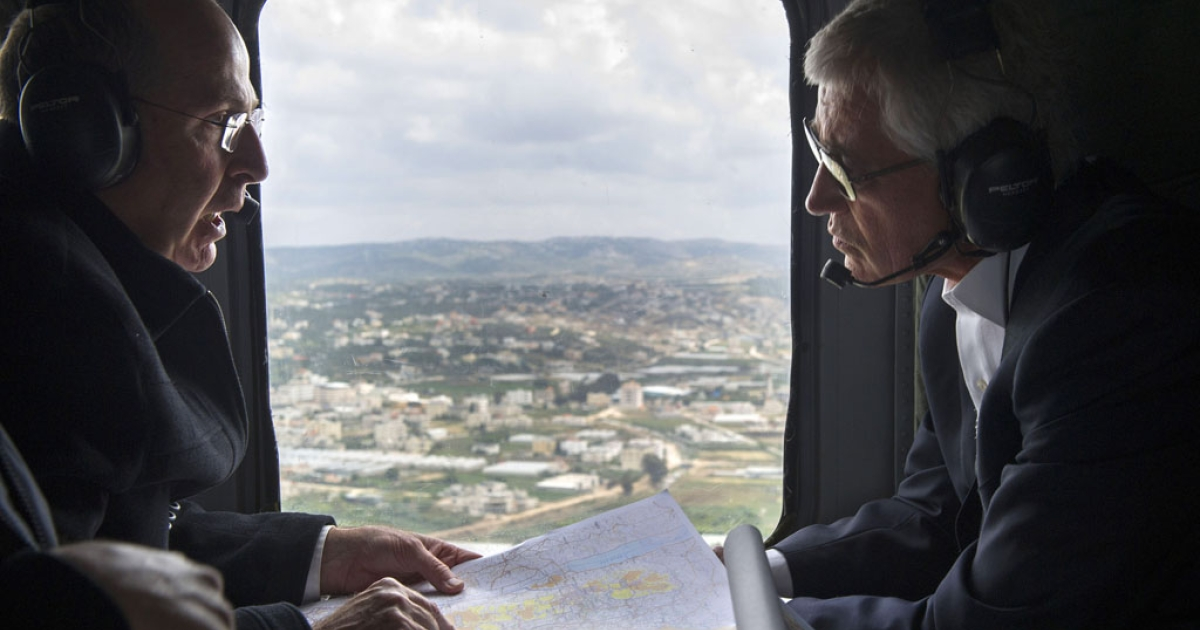 US Secretary of Defense Chuck Hagel and Israeli Minister of Defense Moshe Yaalon speak during a helicopter tour above the Golan Heights, on April 22, 2013. Hagel met his counterpart to put the finishing touches on a major arms deal and for talks on Syria's civil war and the Iranian nuclear threat.</p>