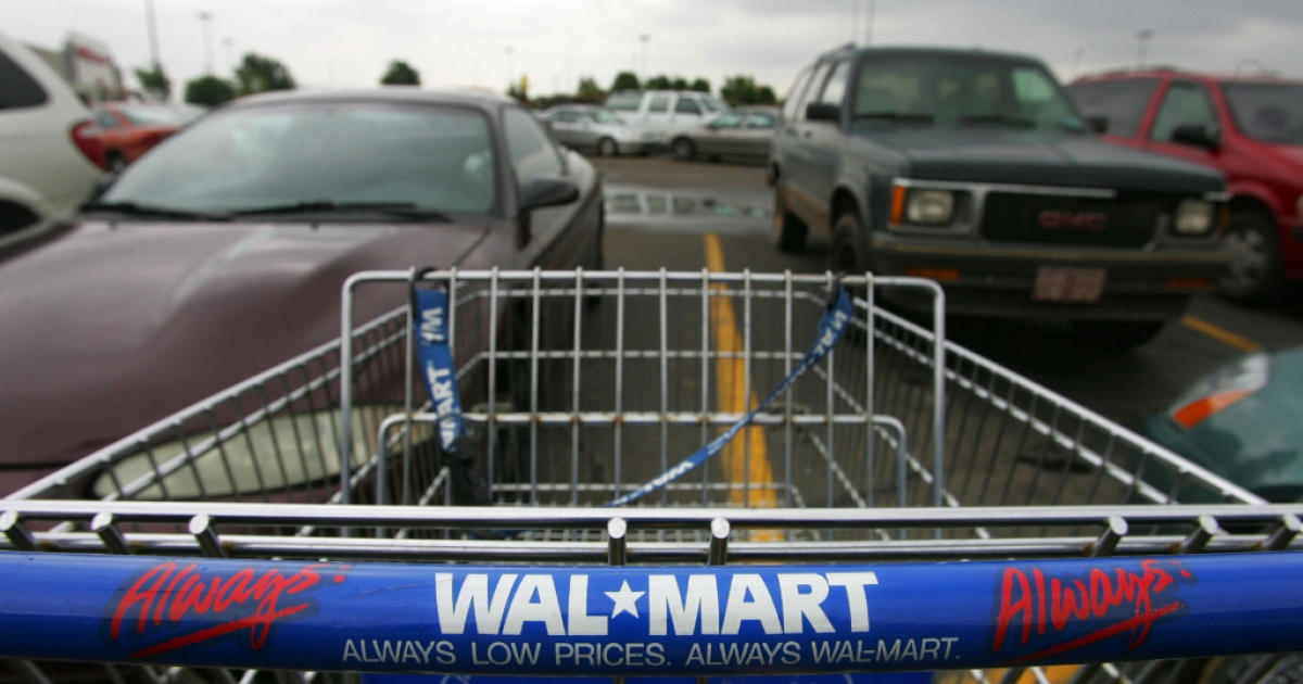 A shopping cart sits in the parking lot of a Wal-Mart in Oklahoma City, Oklahoma.</p>