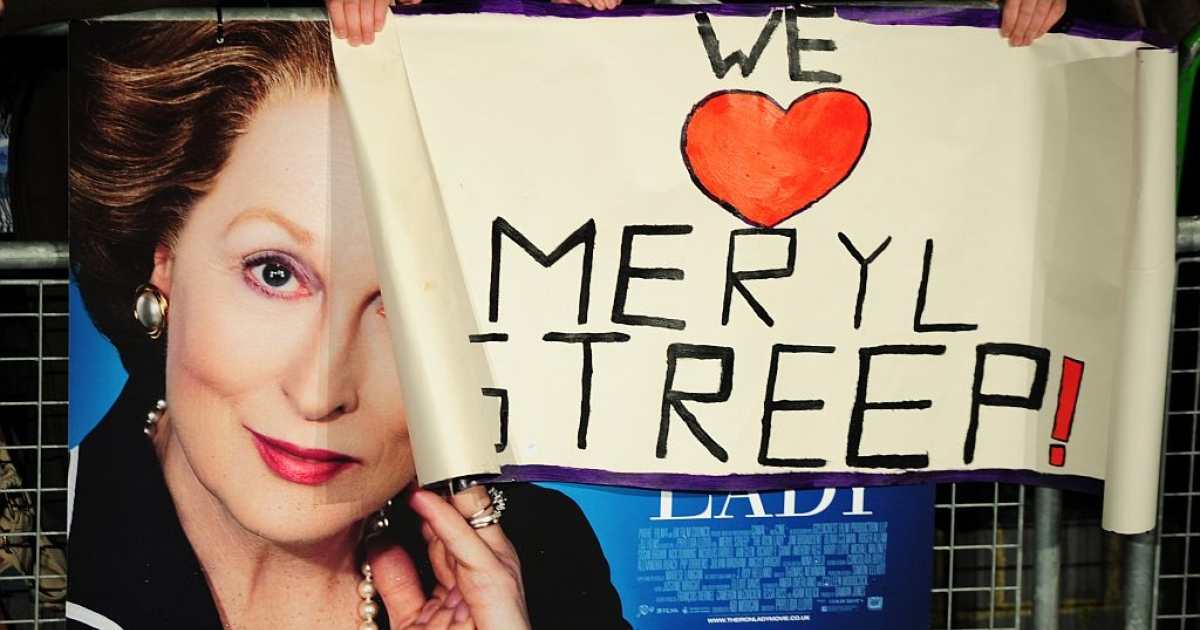 A fan holds a poster reading 'We love Meryl Streep' over a poster promoting the European premiere of the film 'The Iron Lady' at BFI Southbank in London on January 4, 2012.</p>