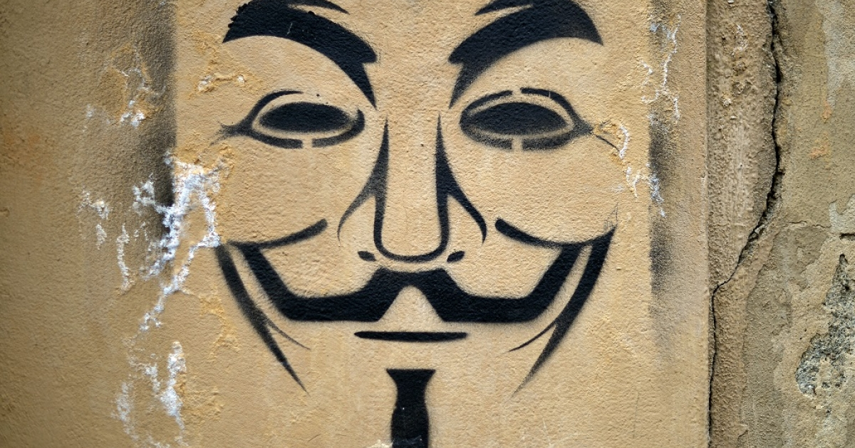 Graffiti of a Guy Fawkes mask, used as a symbol by Anonymous, pictured on April 6, 2013 in Florence.</p>