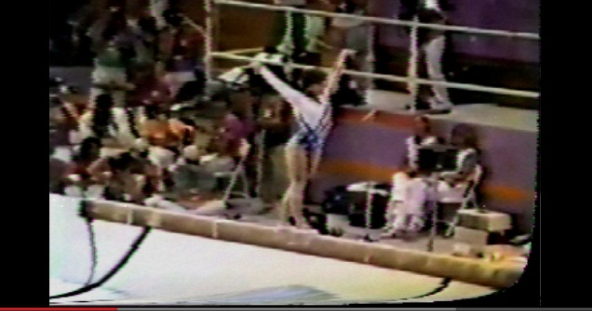 A screenshot of a 'tape mode' video of US gymnast Mary Lou Retton on the balance beam in the 1984 Olympic Games in Los Angeles.</p>