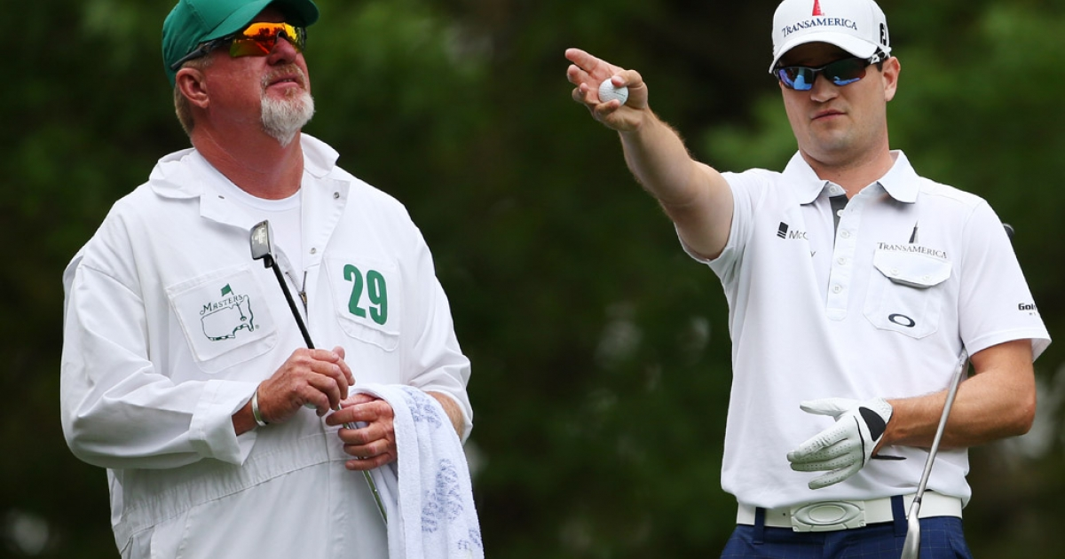 American Zach Johnson and caddie Damon Green discuss strategy during the final round of the Masters at Augusta National Golf Club on April 14, 2013 in Augusta, Georgia.</p>