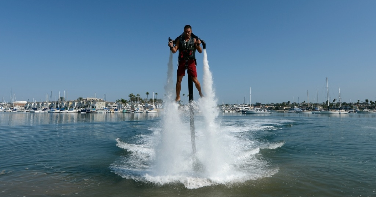 Dean O'Malley rises above the water using a JetLev, a water-powered jetpack, in the Newport Beach harbor on September 25, 2012.</p>