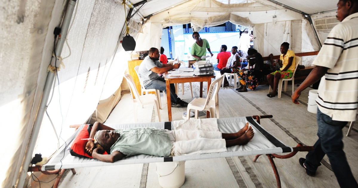 November 15, 2012- People lay in beds as Haitian health authorities deplored a resurgence of cholera after Hurricane Sandy, according to MSF (medecins sans frontieres), with aid tents set up in Delmas, a suburb of Port-au-Prince.</p>
