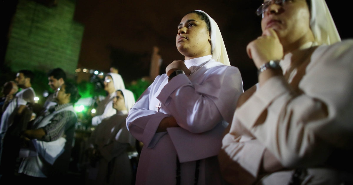 Catholic nuns look on following a Good Friday procession after mass at the Metropolitan Cathedral in Rio de Janeiro, Brazil. Pope Francis is the first pope to hail from South America, with Brazilian Catholics set to receive the pontiff during his visit to Brazil in July for a Catholic youth festival. Brazil has more Catholics than any other country.</p>
