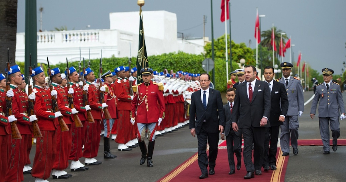 French President Francois Hollande reviews an honour guard with Morocco's King Mohammed VI and Crown Prince Moulay Hassan during a welcoming ceremony in Casablanca on April 3, 2013.</p>