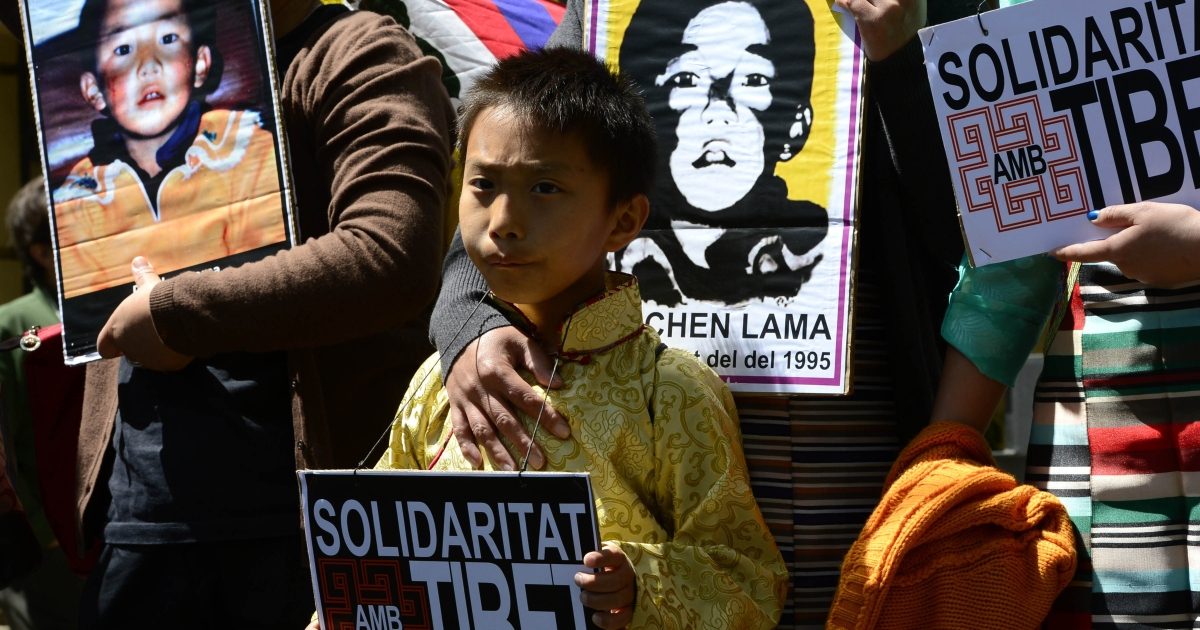 Pro-Tibetan protestors hold pictures of Gendun Cheokyi Nyima (The Panchen Lama) during a demonstration outside the Chinese consulate in Barcelona on May 17, 2013 to demand human rights freedom in Tibet and dialogue between the Dalai Lama and Beijing.</p>