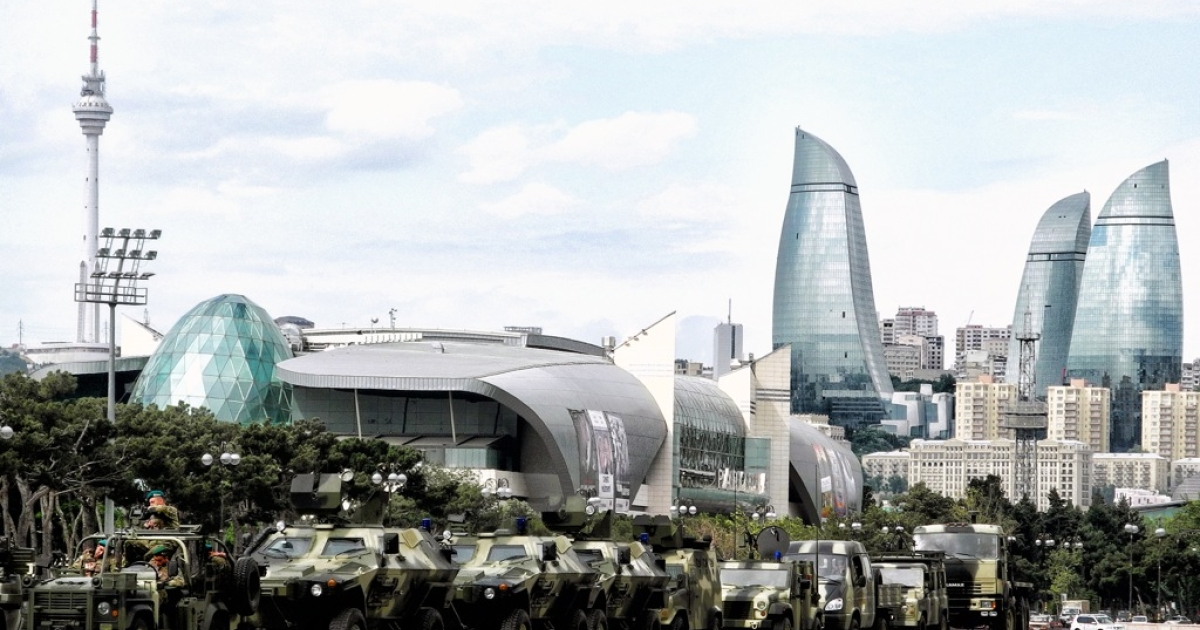 Military vehicles drive through Baku, the capital of Azerbaijan, on June 21, 2013, during a rehearsal for a military parade. Street protests are usually quickly repressed in the authoritarian former Soviet state.</p>