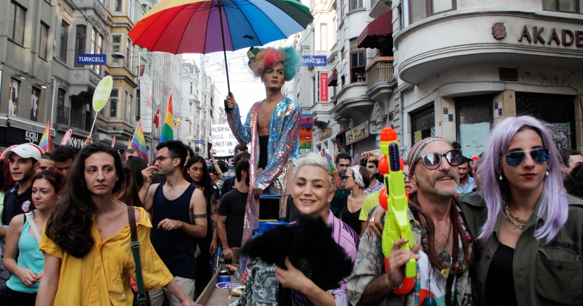 People in Istanbul, Turkey march and chant slogans during a gay parade on Istiklal Street, the main shopping corridor on June 30, 2013 in during the fourth Trans Pride Parade as part of the Trans Pride Week 2013, which is organized by Istanbul's 'Lesbians, Gays, Bisexuals, Transvestites and Transsexuals' (LGBTT) solidarity organization.</p>